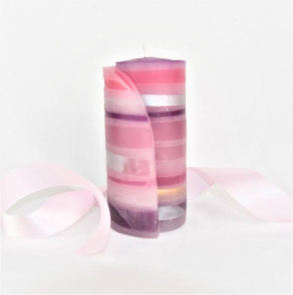 streifenkerze mit rosa band